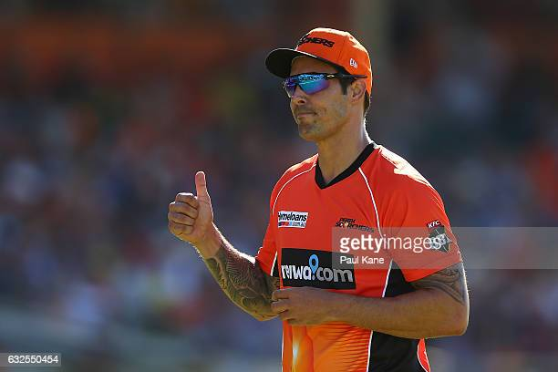 Mitchell Johnson of the Scorchers acknowledges the members after his first over during the Big Bash League match between the Perth Scorchers and the...