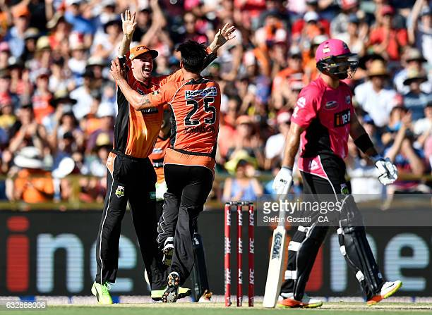 Mitchell Johnson of the Scorchers celebrates the wicket of Daniel Hughes of the Sixers during the Big Bash League match between the Perth Scorchers...