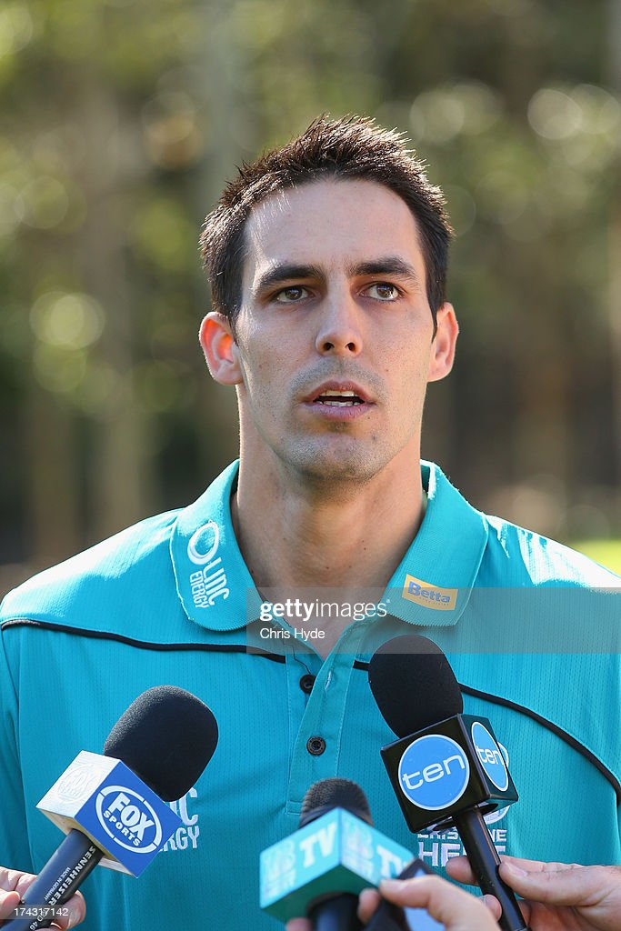 Mitchell Johnson speaks to media during a Brisbane Heat Big Bash League media day at JC Slaughter Fields on July 24, 2013 in Brisbane, Australia.