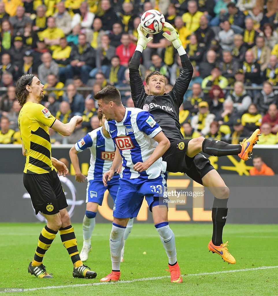 Mitchell Langerak of Borussia Dortmund jumps to save goal the ball against Sandro Wagner of Hertha BSC during the game between Borussia Dortmund and Hertha BSC on May 9, 2015 in Dortmund, Germany.