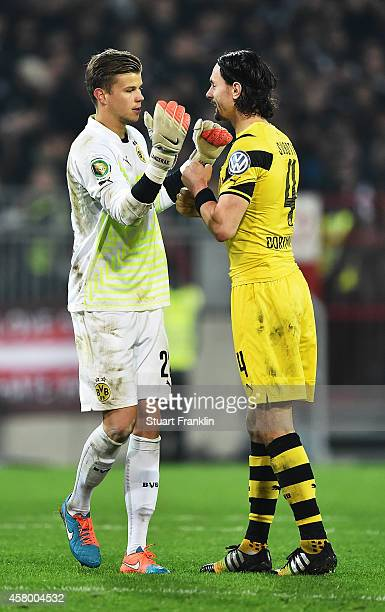Mitchell Langerak of Dortmund is congratulated by Neven Subotic after the DFB Cup match between FC St Pauli and Borussia Dortmund at Millerntor...