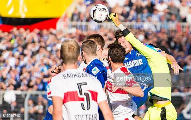 Mitchell Langerak of Stuttgart challenges Dennis Kempe of Karlsruhe during the Second Bundesliga match between Karlsruher SC and VfB Stuttgart at...