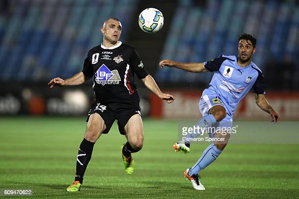 Mitchell Mallia of Blacktown City and Michael Zullo of Sydney FC contest the ball during the FFA Cup Quarter Final between Blacktown and Sydney FC on...