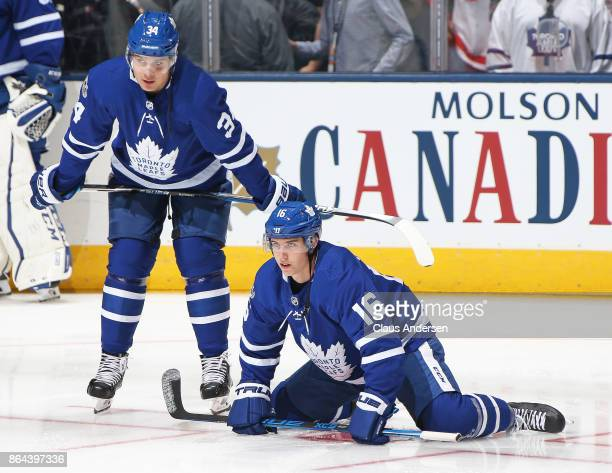 Mitchell Marner and Auston Matthews of the Toronto Maple Leafs chat during the warmup prior to playing against the Detroit Red Wings in an NHL game...