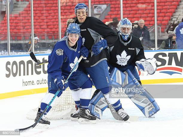Mitchell Marner Frank Corrado and Frederik Andersen of the Toronto Maple Leafs practice a day ahead of the 2017 Scotiabank NHL Centenial Classic at...