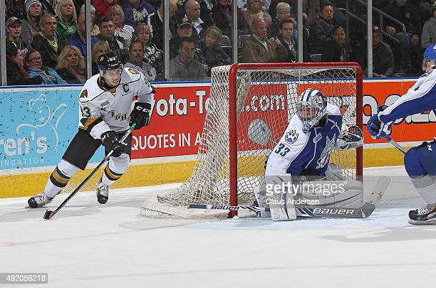 Mitchell Marner of the London Knights looks to get a shot past Troy Timpano of the Sudbury Wolves during an OHL game at Budweiser Gardens on October...