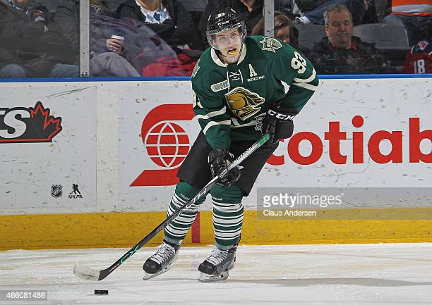 Mitchell Marner of the London Knights skates with the puck against the Kitchener Rangers during an OHL game at Budweiser Gardens on March 12 2015 in...