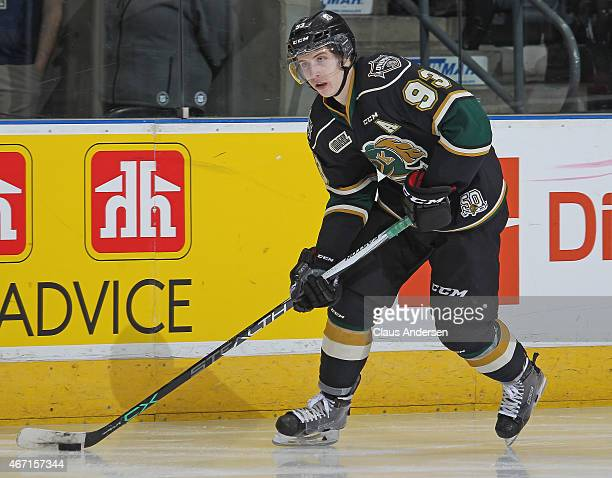 Mitchell Marner of the London Knights skates with the puck against the Saginaw Spirit during an OHL game at Budweiser Gardens on March 20 2015 in...