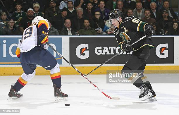 Mitchell Marner of the London Knights steps around Dylan Strome of the Erie Otters during Game Three of the OHL Western Conference Final on April 26...
