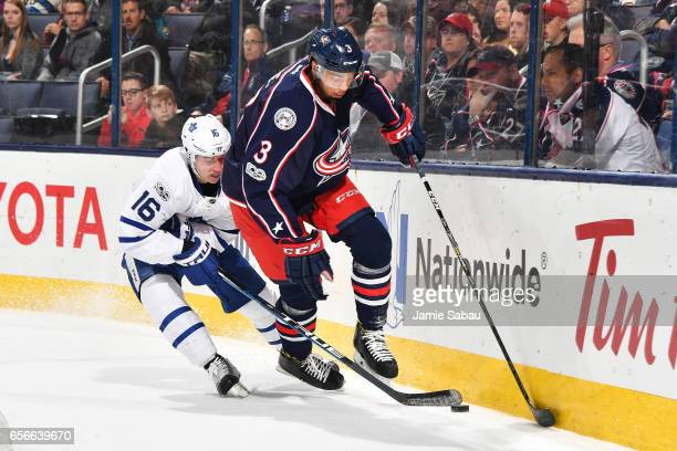 Mitchell Marner of the Toronto Maple Leafs attempts to take the puck from Seth Jones of the Columbus Blue Jackets during the second period of a game...
