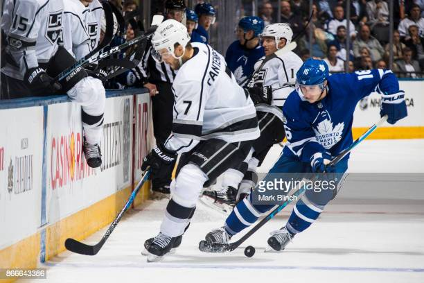 Mitchell Marner of the Toronto Maple Leafs battles for the puck with Oscar Fantenberg of the Los Angeles Kings during the third period at the Air...