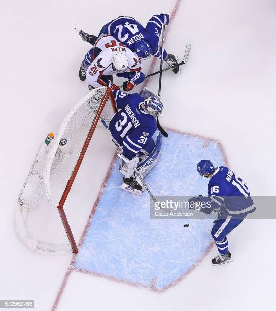 Mitchell Marner of the Toronto Maple Leafs gets set to clear a puck for teammate Frederik Andersen against the Washington Capitals in Game Six of the...
