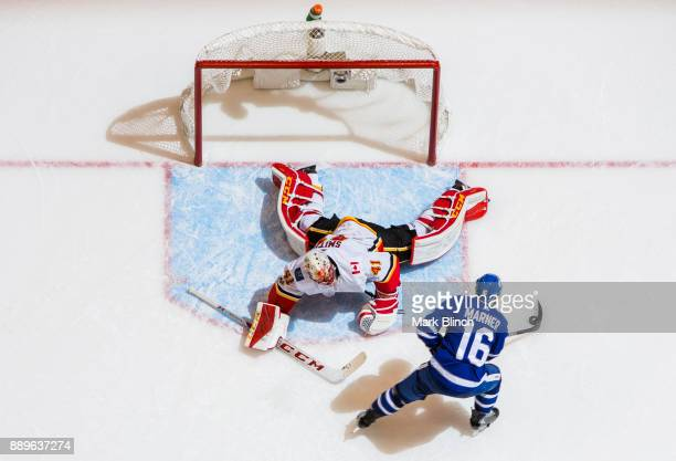Mitchell Marner of the Toronto Maple Leafs goes to the net against Mike Smith of the Calgary Flames in the shootout at the Air Canada Centre on...