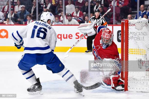 Mitchell Marner of the Toronto Maple Leafs is stopped by goaltender Carey Price of the Montreal Canadiens during the NHL game at the Bell Centre on...
