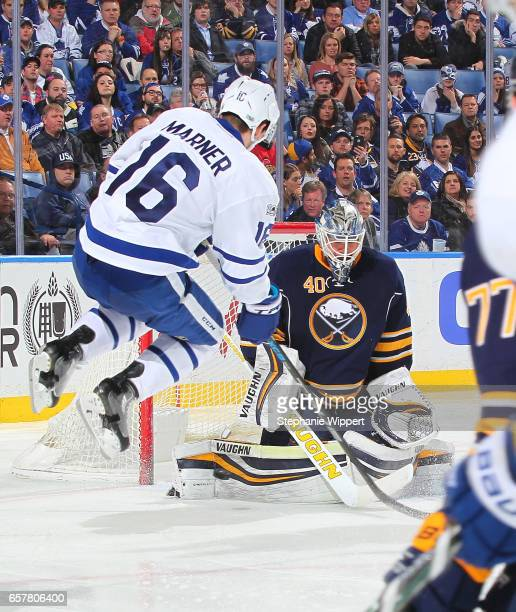 Mitchell Marner of the Toronto Maple Leafs jumps to screen Robin Lehner of the Buffalo Sabres during an NHL game at the KeyBank Center on March 25...
