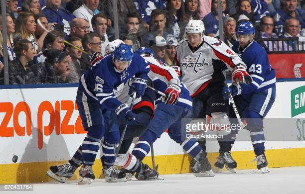 Mitchell Marner of the Toronto Maple Leafs looks to come up with a loose puck against the Washington Capitals in Game Four of the Eastern Conference...