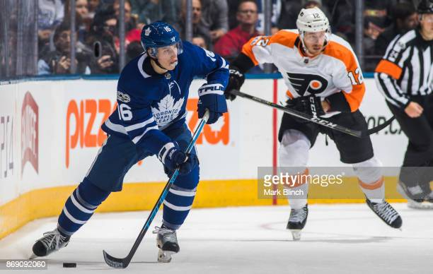 Mitchell Marner of the Toronto Maple Leafs skates against Michael Raffl of the Philadelphia Flyers during the first period at the Air Canada Centre...