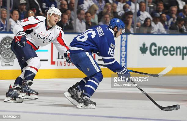 Mitchell Marner of the Toronto Maple Leafs skates away from John Karlson of the Washington Capitals in Game Three of the Eastern Conference...