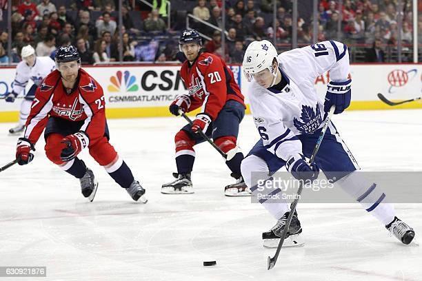 Mitchell Marner of the Toronto Maple Leafs skates in front of Karl Alzner of the Washington Capitals during the first period at Verizon Center on...