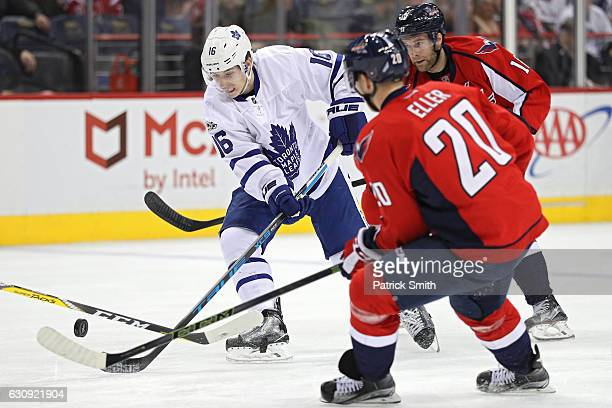 Mitchell Marner of the Toronto Maple Leafs skates past Brett Connolly of the Washington Capitals during the first period at Verizon Center on January...