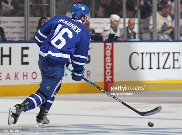 Mitchell Marner of the Toronto Maple Leafs takes off with the puck against the Washington Capitals in Game Three of the Eastern Conference...