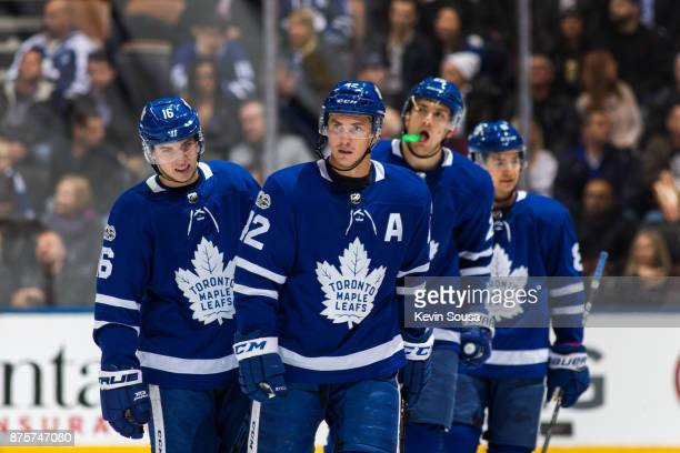 Mitchell Marner of the Toronto Maple Leafs Tyler Bozak James van Riemsdyk and Connor Carrick skate to the bench against the New Jersey Devils during...
