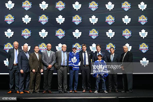 Mitchell Marner poses after being selected fourth overall by the Toronto Maple Leafs in the first round of the 2015 NHL Draft at BBT Center on June...