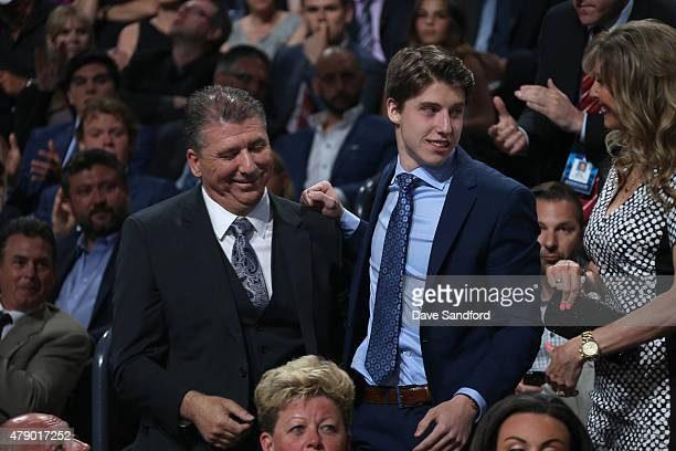 Mitchell Marner reacts after being selected fourth overall by the Toronto Maple Leafs during Round One of the 2015 NHL Draft at BBT Center on June 26...