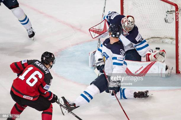 Mitchell Marner scores a goal against Joonas Jarvinen and Goalie Harri Sateri during the Ice Hockey World Championship between Canada and Finland at...