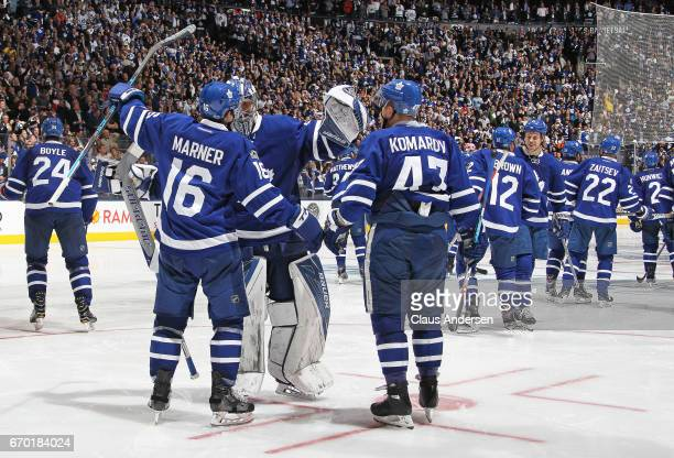 Mitchell MarnerLeo Komarov and the rest of the Toronto Maple Leafs celebrate an overtime victory against the Washington Capitals in Game Three of the...