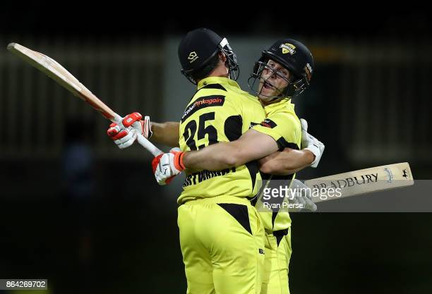 Mitchell Marsh and Hilton Cartwright of of the Warriors celebrate after hitting the winning runs during the JLT One Day Cup Final match between...