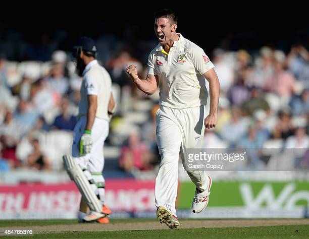 Mitchell Marsh of Australia celebrates dismissing Stuart Broad of England during day two of the 5th Investec Ashes Test match between England and...