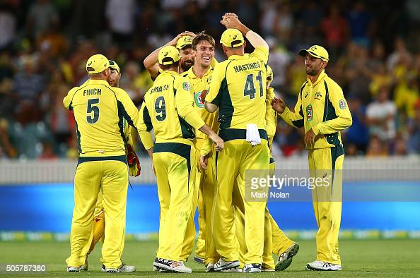 Mitchell Marsh of Australia celebrates the final wicket with team mates during the Victoria Bitter One Day International match between Australia and...