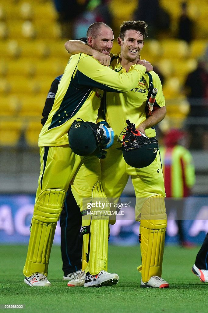 Mitchell Marsh of Australia (R) celebrates with teammate John Hastings as they walk off the field during the second one-day international cricket match between New Zealand and Australia at Westpac Stadium in Wellington on February 6, 2016. AFP PHOTO / MARTY MELVILLE / AFP / Marty Melville