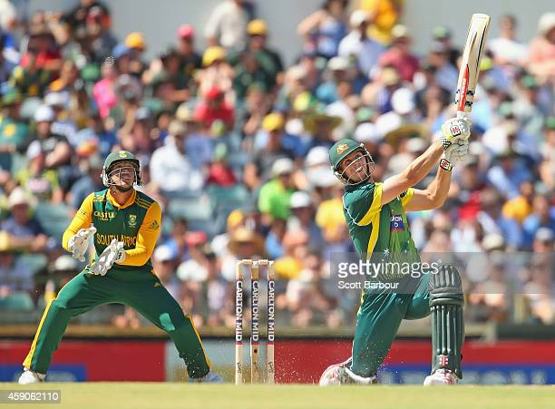 Mitchell Marsh of Australia hits a six as wicketkeeper Quinton de Kock of South Africa looks on during the One Day International match between...