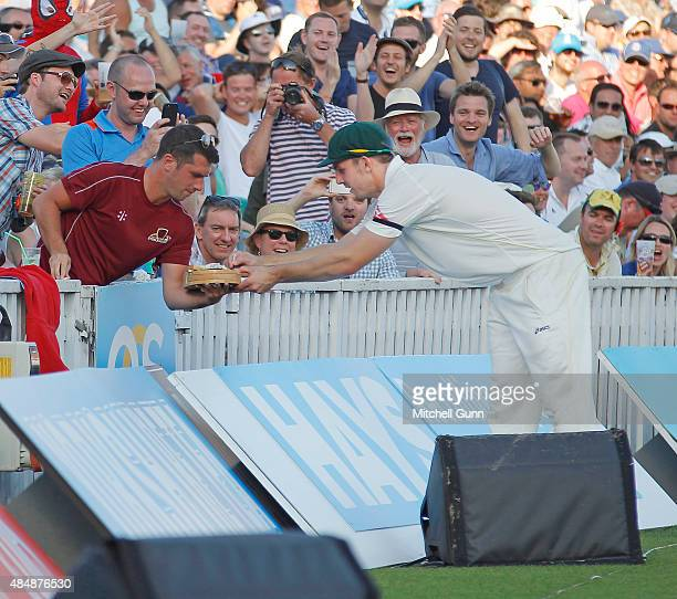 Mitchell Marsh of Australia signs a fans cheese board during day three of the 5th Investec Ashes Test match between England and Australia at The Kia...
