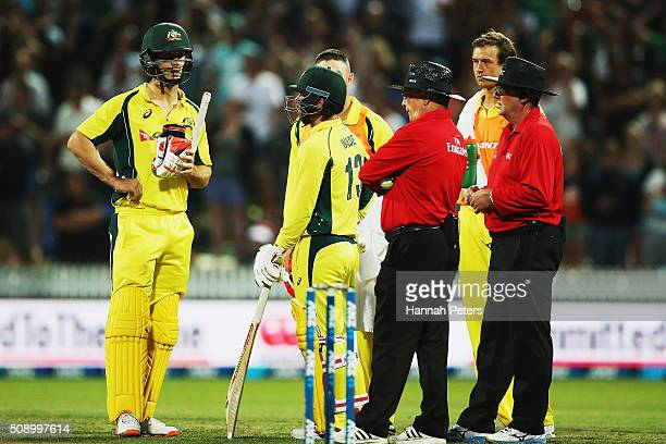 Mitchell Marsh of Australia waits as the umpires watch a replay during the 3rd One Day International cricket match between the New Zealand Black Caps...