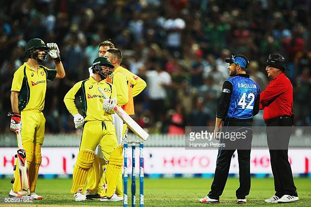 Mitchell Marsh of Australia waits as the umpires watch a replay with Brendon McCullum of the Black Caps during the 3rd One Day International cricket...