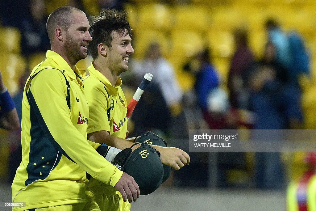 Mitchell Marsh of Australia (R) walks off the field with teammate John Hastings after their win in the second one-day international cricket match between New Zealand and Australia at Westpac Stadium in Wellington on February 6, 2016. AFP PHOTO / MARTY MELVILLE / AFP / Marty Melville