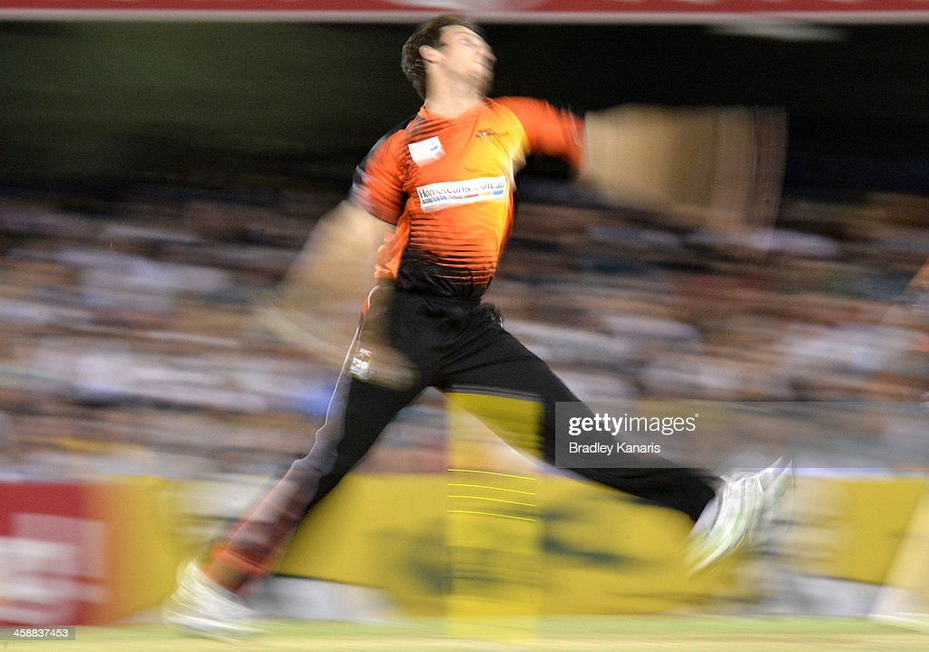 Mitchell Marsh of the Scorchers bowls during the Big Bash League match between the Brisbane Heat and the Perth Scorchers at The Gabba on December 22, 2013 in Brisbane, Australia.