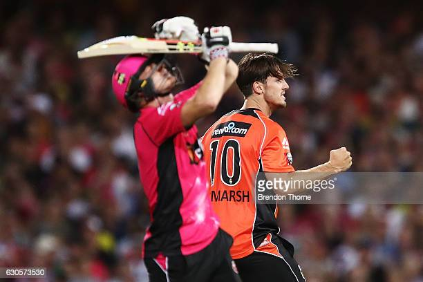 Mitchell Marsh of the Scorchers celebrates after claiming the wicket of Sam Billings of the Sixers during the Big Bash League match between the...