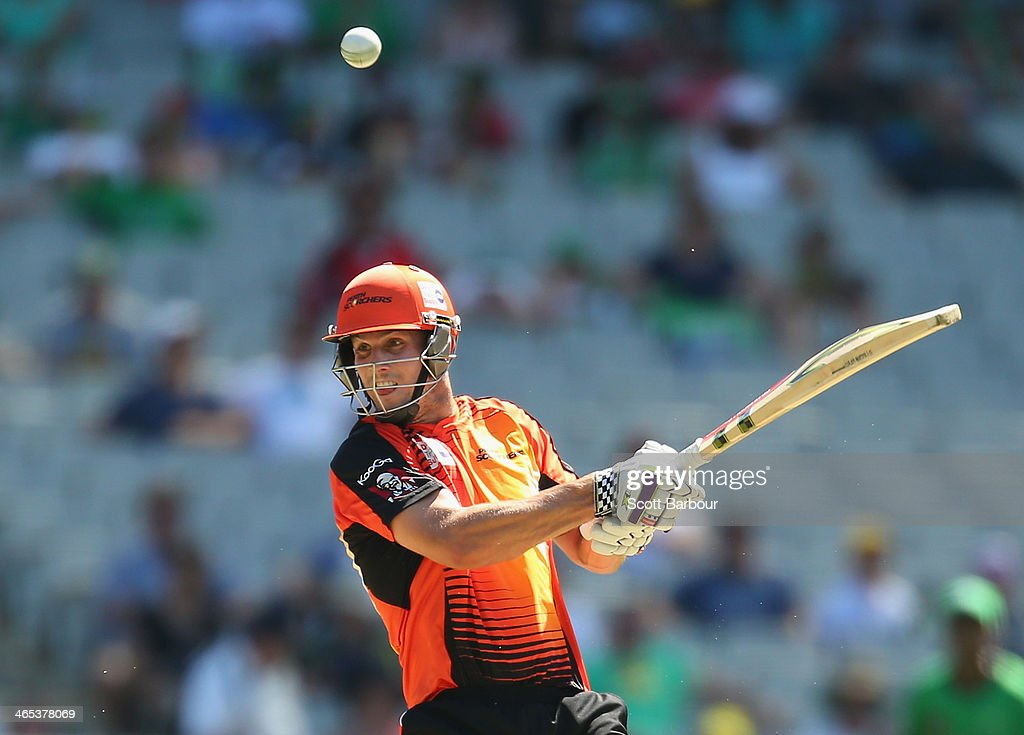 Mitchell Marsh of the Scorchers hits the ball in the air and is out caught during the Big Bash League match between the Melbourne Stars and the Perth Scorchers at Melbourne Cricket Ground on January 27, 2014 in Melbourne, Australia.