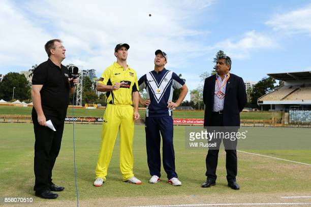 Mitchell Marsh of the Warriors and Cameron White of the Bushrangers at the coin toss during the JLT One Day Cup match between Victoria and Western...