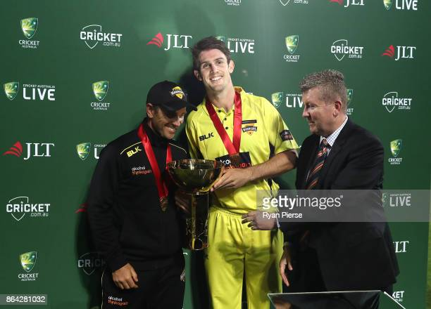 Mitchell Marsh of the Warriors and Warriors coach Justin Langer celebrate with the trophy during the JLT One Day Cup Final match between Western...