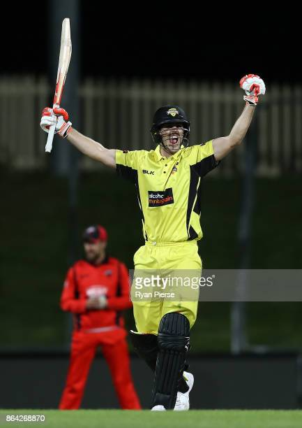 Mitchell Marsh of the Warriors celebrates after hitting the winning runs during the JLT One Day Cup Final match between Western Australia and South...