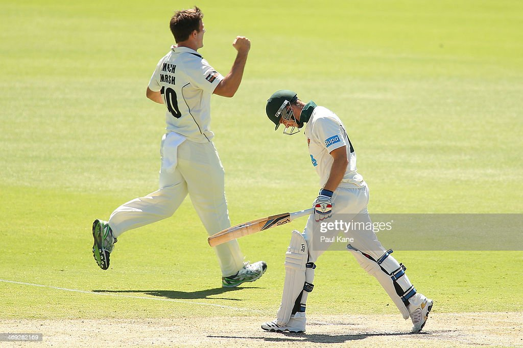 Mitchell Marsh of the Warriors celebrates the dismissal of <a gi-track='captionPersonalityLinkClicked' href=/galleries/search?phrase=Tim+Paine&family=editorial&specificpeople=3990549 ng-click='$event.stopPropagation()'>Tim Paine</a> of the Tigers during day three of the Sheffield Shield match between the Western Australia Warriors and the Tasmania Tigers at the WACA on February 14, 2014 in Perth, Australia.
