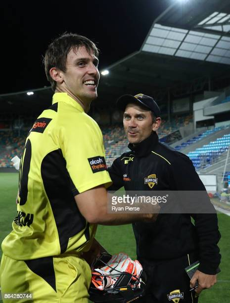 Mitchell Marsh of the Warriors celebrates with Warriors coach Justin Langer after hitting the winning runs during the JLT One Day Cup Final match...