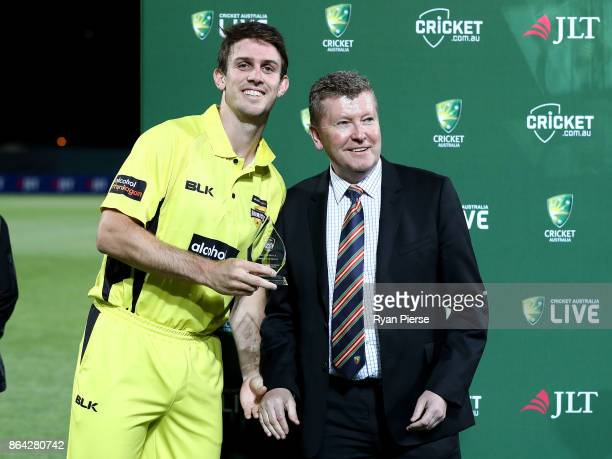 Mitchell Marsh of the Warriors is awarded the player of the match award during the JLT One Day Cup Final match between Western Australia and South...