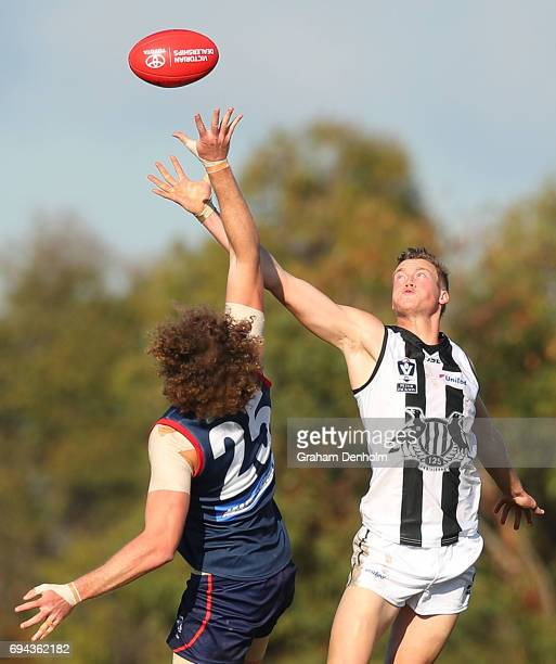 Mitchell Mccarthy of Collingwood and Jake Spencer of the Casey Demons compete in the air during the round eight VFL match between Casey Demons and...
