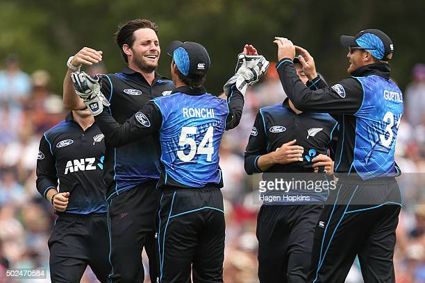 Mitchell McClenaghan and Luke Ronchi of New Zealand celebrate after taking the wicket of Nuwan Kulasekara of Sri Lanka during the first One Day...